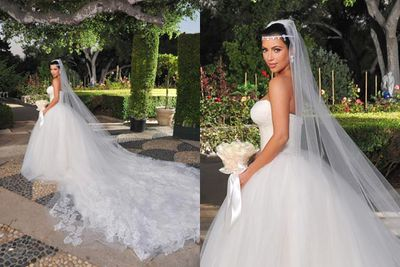 Kim Kardashian wore not one but THREE Vera Wang dresses for her wedding to Kris. You know, like it was an awards ceremony or pop concert. First up was the Cinderella-inspired ball-gown with a full tulle skirt, basqure waist and hand-pieced Chantilly lace applique on the bodice and train... with an estimated cost of $20,000.<br/><br/>According to the <i>New York Post</i>, Kim was given the dress for free, along with the next two $20,000 evening gowns...<br/><br/>Images: Snapper