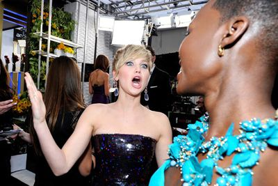 Jen did her quirkiest face possible when meeting <i>12 Years a Slave</i>'s Lupita Nyong'o, who pipped Jen at the post for the Best Supporting Actress SAG Award.
