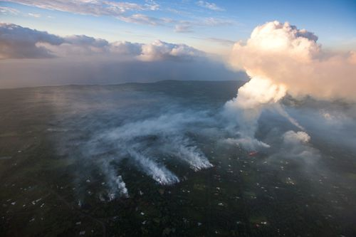 The volcano eruption sends a huge plume of gas and smoke skyward. (AAP)