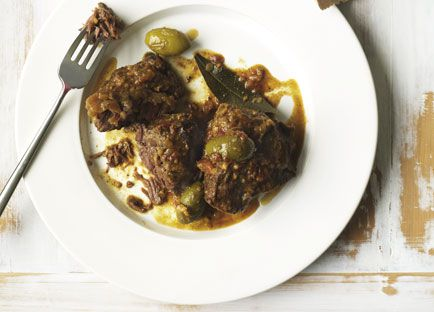 Spanish braised beef cheeks with tomato bread, parsley and anchovy salad