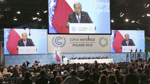UN Secretary General Antonio Guterres appears on screens when delivering a speech during the opening of COP24 UN Climate Change Conference 2018 in Katowice, Poland.