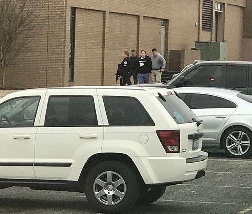 Police escort a 15-year-old student, second from right, out of the Marshall County High School after the shooting. (AAP)