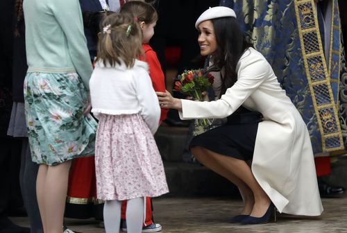 The royal bride-to-be chatted to a couple of youngsters outside. Picture: PA/AAP