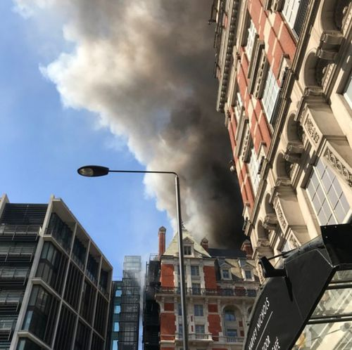 Thick black smoke can be seen covering the Knightsbridge area. (Twitter)