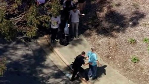 This image taken from video from KGO-TV shows a person is searched as police respond to reports of a shooting at YouTube headquarters in the city of San Bruno. (AP)
