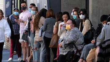 People are seen lining up to get tested for Coronavirus at the Royal Melbourne Hospital on Tuesday 10 March 2020