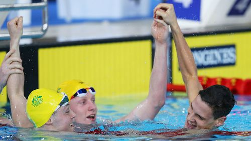 Larkin (right) celebrated with Beaver (left) and Lawson following the 200m backstroke final.