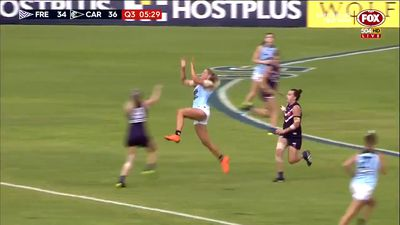 AFLW players injured in heavy collision during Fremantle Dockers win over Carlton
