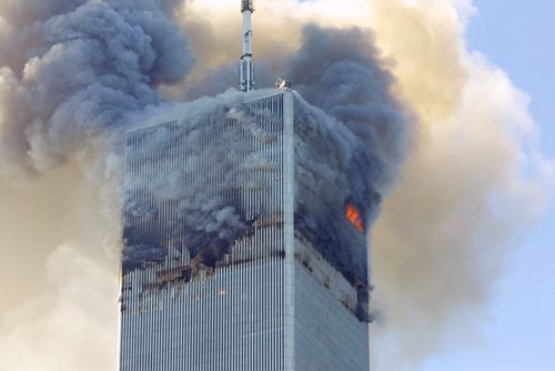 Smoke billows from the 110-storey north tower at the World Trade Centre.