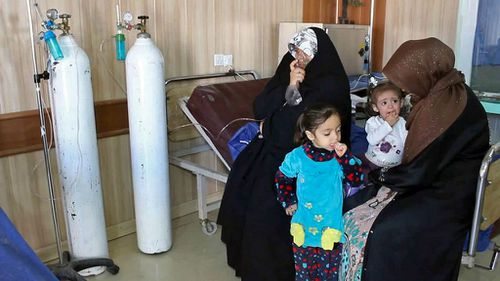 People exposed to a chemical attack wait for treatment at a hospital in Taza. (AAP)