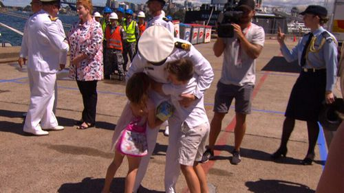Children were quick to give their parents a long overdue big hug (9NEWS)