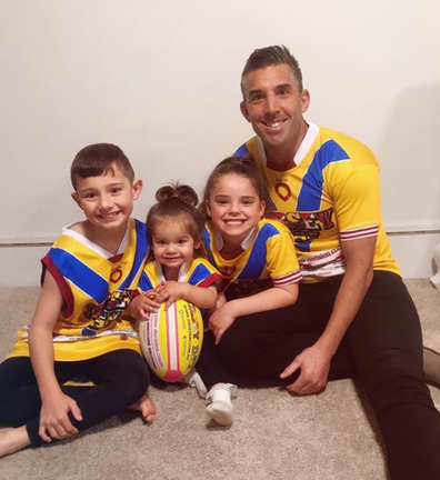 Braith Anasta and children wearing jerseys