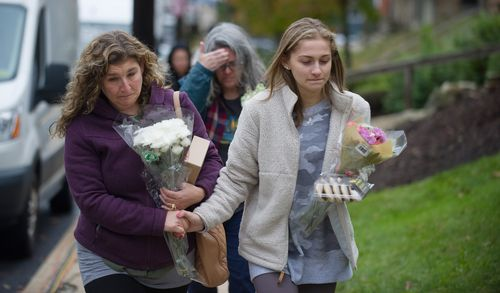 Mourners arrive outside the Tree of Life synagogue a day after the mass shooting.
