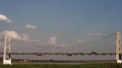 Cars and pedestrians make their way across the Samora Machel bridge in Tete, Mozambique.