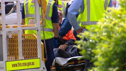 The man was rescued from the crane and taken to St George Hospital for testing.