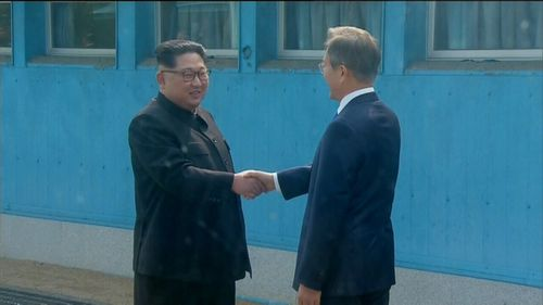 Kim said his heart was 'throbbing' as he shook Moon's hand.