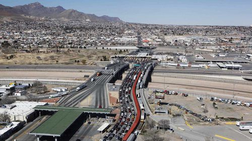 The border between Mexico and the United States. Trucks stream from El Paso in the US (left) as traffic is clogged from Ciudad Juarez, Mexico, on the right. (AAP)