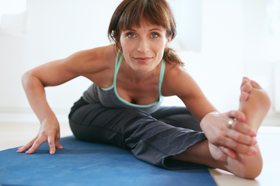 Woman stretching with bare feet
