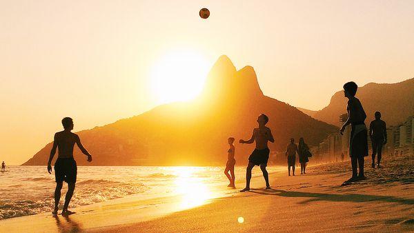 People playing football on Ipanema beach (Getty)