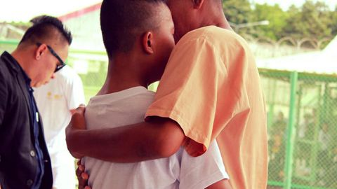 A teenage boy was reunited with his father, an inmate on a school visit to a prison in Thailand