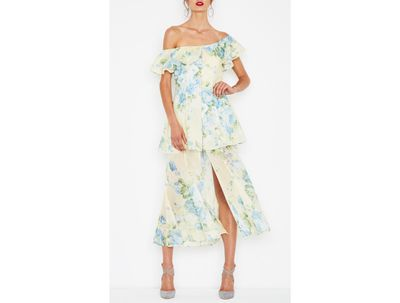 A breezy Melbourne Cup finish. Florals tick the box on the big day and the long skirt balances out the bare shoulders. Add a wide brim hat and you're in the starting gates.
