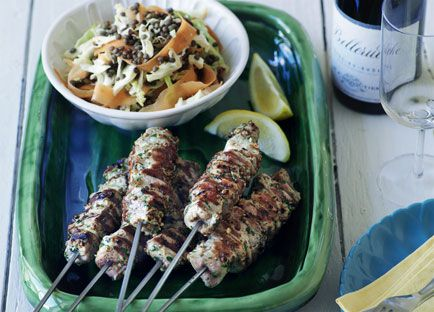 Barbecued pork and coriander kebabs with cabbage, carrot and lentil salad