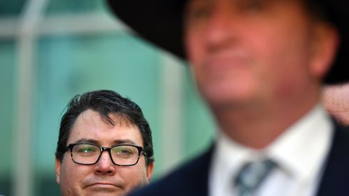 Nationals MP George Christensen looks on at the former Deputy Prime Minister in June. (AAP)