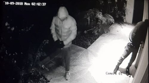 CCTV shows the masked men at the door just moments before they stormed in.