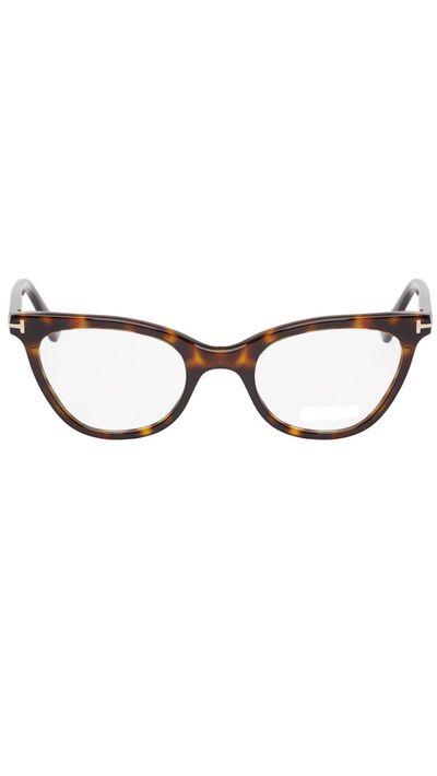 "<p><a href=""https://www.ssense.com/en-us/women/product/tom-ford/black-tortoiseshell-cat-eye-optical-glasses/1147963"" target=""_blank"">Black Tortoiseshell Cat-Eye Optical Glasses, approx. $522, Tom Ford</a></p>"
