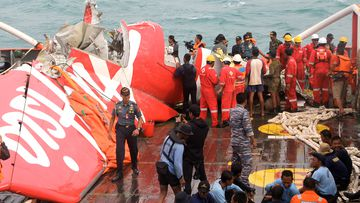 Parts of AirAsia Flight 8501 are brought out of the water. (Getty Images)