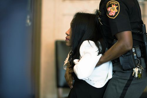 Former judge Tracie Hunter flopped and had to be dragged out of court after hearing she would spend six-months in jail.