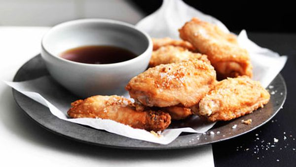 Crisp chicken wings with fried shallots and red wine vinegar