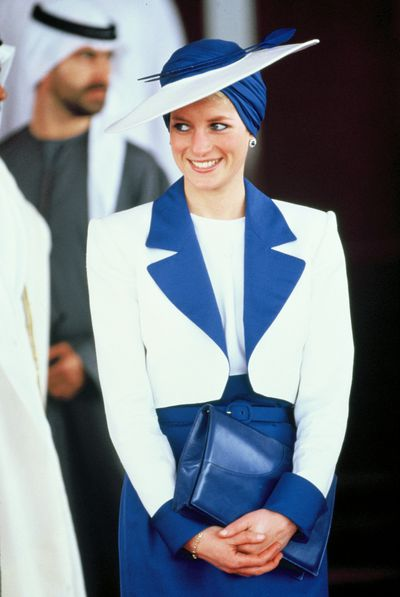 In a Catherine Walker suit and a Philip Somerville turban hat during her official tour of the Gulf States in 1989.