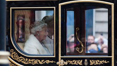Queen Elizabeth II arriving in a coach to the Houses of Parliament to deliver Queen's Speech