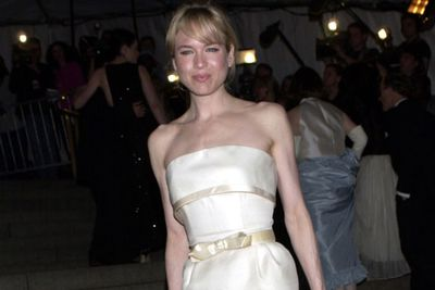 Shiny dress... even shinier face! <br/><br/>Renee may have happily sashayed in satin at the 2001 Met Gala, but her bony frame made more headlines than her pursed pout. <br/>