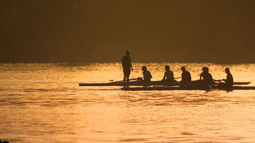 Rowers beating the heat on Albert Park Lake this morning.