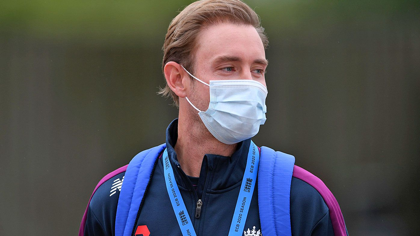 England's Stuart Broad wears a face mask as a precaution against the coronavirus