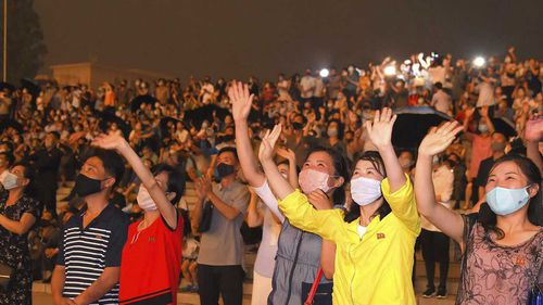 People wearing face masks to help curb the spread of the coronavirus in Pyongyang, North Korea.