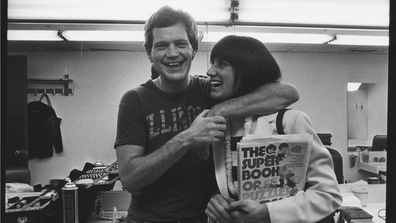 David Letterman poses in his dressing room with girlfriend Merrill Markoe during a 1982 photo portrait session in New York City, New York.