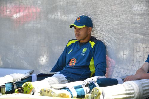 Usman Khawaja takes a moment out in the nets today ahead of Thursday's opening Test against India in Adelaide.