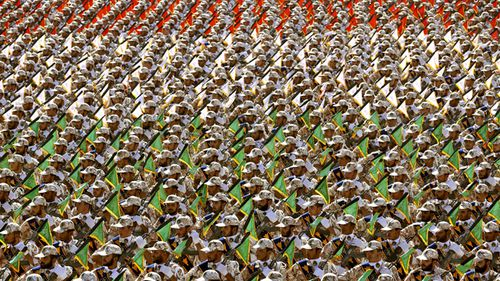 Members of the Iran's Revolutionary Guard march during an annual military parade at the mausoleum of Ayatollah Khomeini, outside Tehran, Iran.