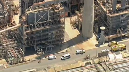 The worker was rescued about 1.15pm (9NEWS)