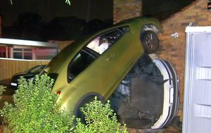 Car captured speeding through fence and smashing into van