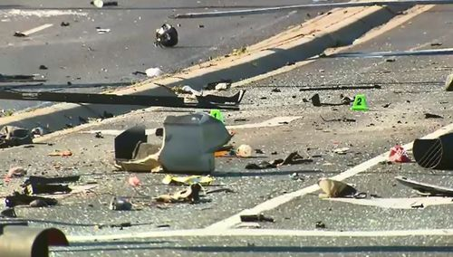 Police spent much of the day cleaning up debris from the crash.