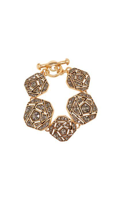 "<a href=""http://www.theoutnet.com/en-AU/product/Oscar-de-la-Renta/Gold-tone-crystal-bracelet/587862"">Gold-Tone Crystal Bracelet, $298, Oscar De La Renta</a>"
