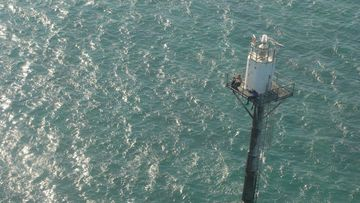 Tale of survival: fishermen found clinging to marker buoy 41km north-east of Darwin