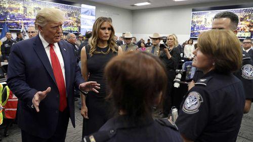 Donald Trump and his wife Melania speak to El Paso emergency responders.