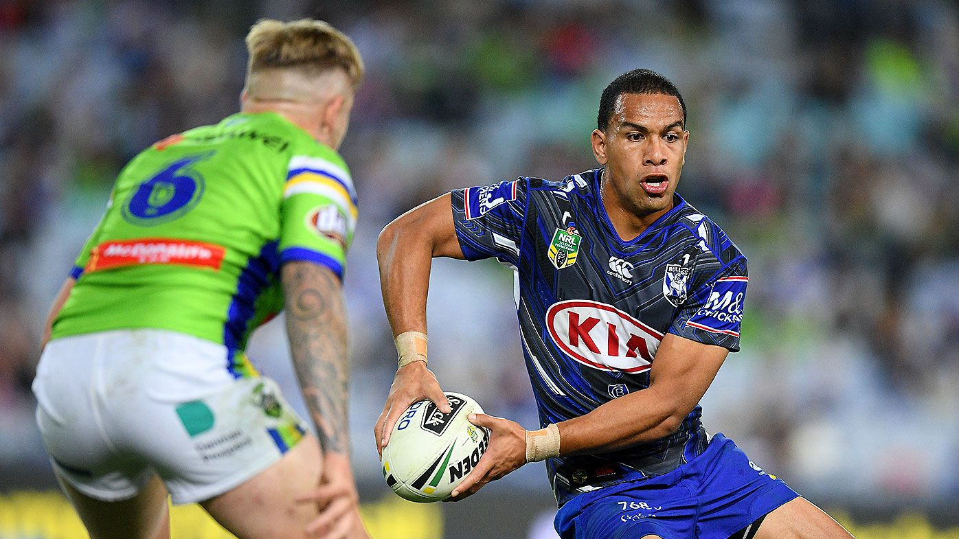 Will Hopoate of the Bulldogs looks to pass the ball