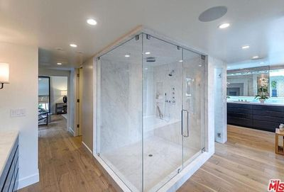 The floor-to-ceiling marble steam room and shower gives you the option: traditional, or rain shower?