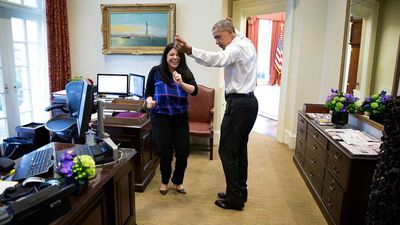 The president busts a move with personal aide Ferial Govashiri.